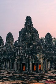 Buddhist monks in a temple, at sunrise, Angkor wat, Cambodia