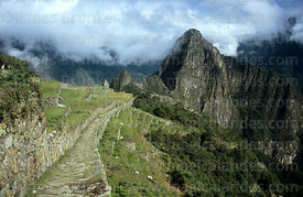 The Inca Trail arriving at Machu Picchu, Huayna Picchu peak in background, Peru