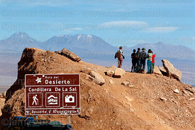 Tourists at viewpoint near San Pedro de Atacama, Acamarachi (L) and Lascar volcanos in background, Region II, Chile