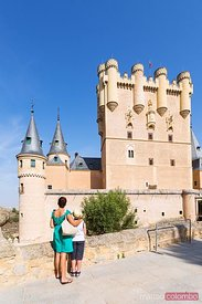 Tourists looking at the Alcazar of Segovia, Spain