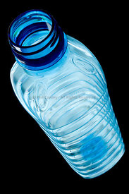Empty Plastic Bottle on a black background