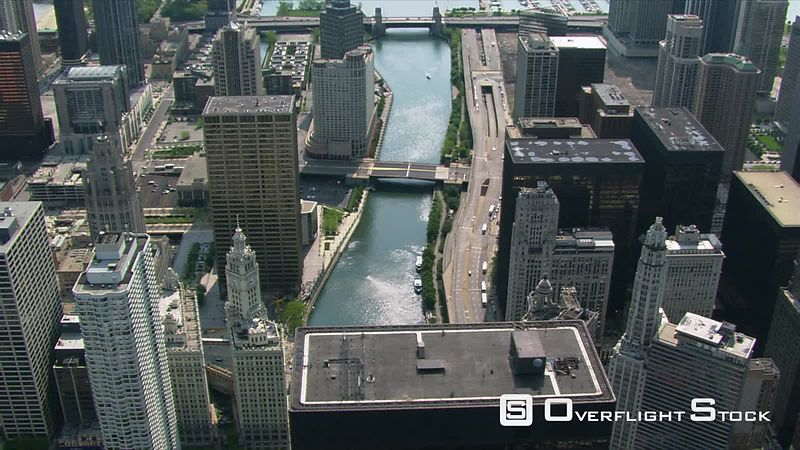 Looking down at the Chicago River among skyscrapers.