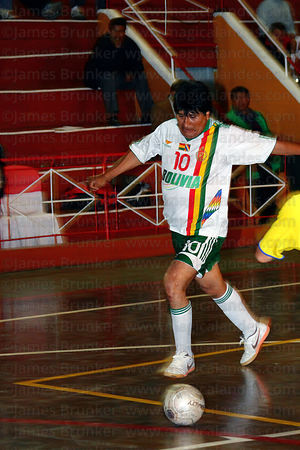 Bolivian president Evo Morales runs with the ball at a futsal tournament, La Paz, Bolivia