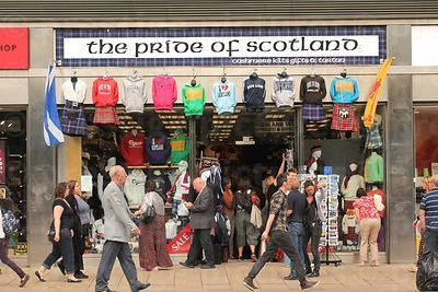 Pedestrians passing by The Pride of Scotland tourist  clothing and gift shop