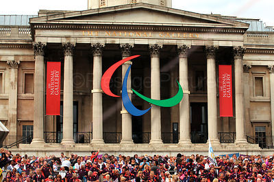 Paralympic Symbol Comprising 3 Agitos on the Pillars of London's National Gallery with hundreds of Volunteer Gamesmakers below