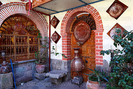 Ceramics for sale in courtyard of handicraft shop, San Blas district, Cusco, Peru