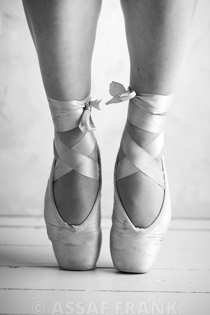 Close-up of a ballerina standing on tiptoe