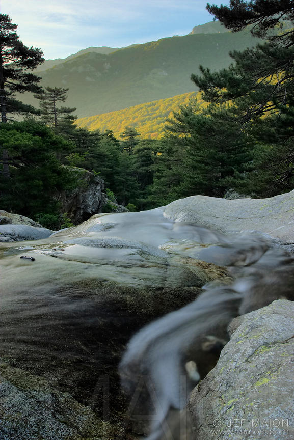 Mountain stream and sunrise on mountain