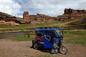 Motorised tricycle taxi and rock formations of Tinajani Canyon , near Ayaviri , Puno department , Peru