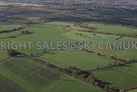 Farming Landscape aerial photograph of man made field boundaries divided by trees hedgerows and tree coppices