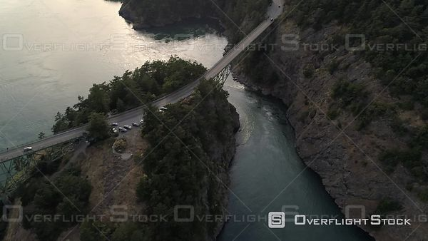 Looking down on huge Deception Pass bridge with cars traveling by the San Juan Islands. Deception Pass Washington USA