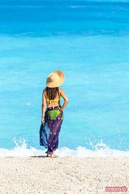 Woman with straw hat on famous Myrtos beach. Kefalonia, Greek Islands, Greece (MR)