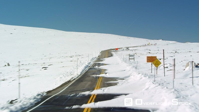 A dramatic section of Highway U.S. 212 known as the Beartooth Highway winds its way through the rugged Beartooth mountain range in southwestern Montana, near Yellowstone National Park