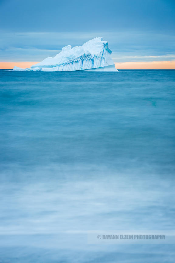 Long exposure of iceberg at sunset in the Disko Bay in Greenland