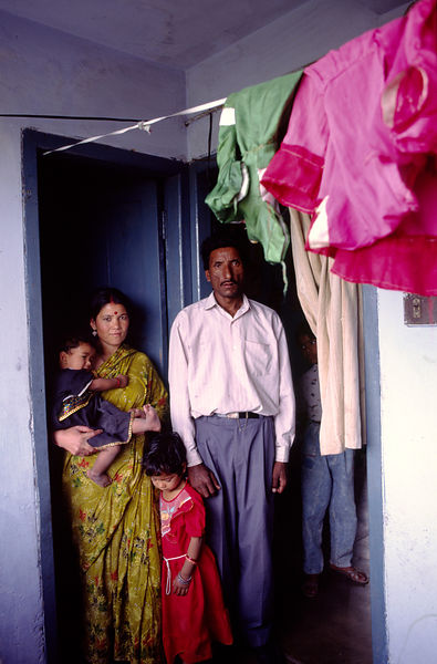 India - Chandigarh - A family outside their apartment in Chandigarh