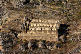 Inca building thought to be a storehouse on side of Cerro Pinkuylluna above village of Ollantaytambo, Sacred Valley, Peru