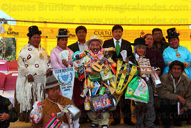Ricardo Paco (centre, the official ekeko) with officials at the inauguration ceremony for the Alasitas festival, La Paz, Bolivia