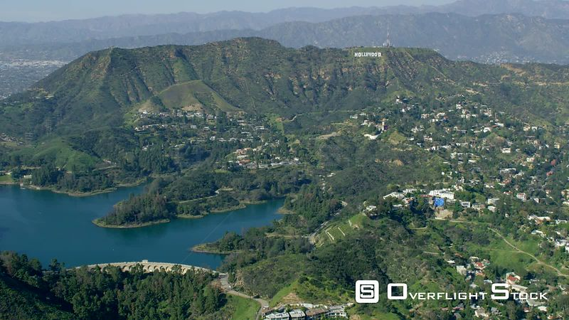 Red Epic Video Los Angeles California USA. the world famous Hollywood sign with the Hollywood Reservoir in the foreground second half of clip has the Beachwood canyon area in foreground