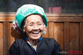 Old chinese Zhuang minority  lady smiling, China