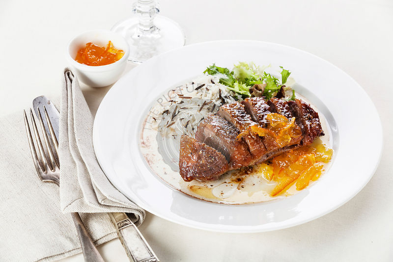 Roasted Duck Breast with rice and orange sauce