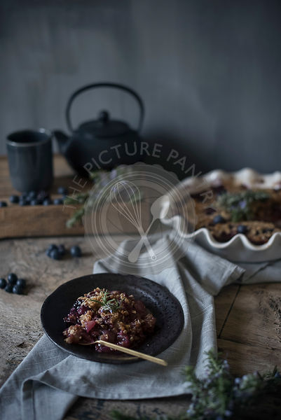 Blueberry, pear and blackberry crumble in a bowl