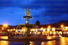 Statue of the Inca Pachacuti Inca Yupanqui or Pachacutec on fountain and Plaza de Armas at sunset, Cusco, Peru