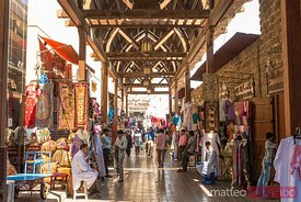 The textile souk with tourists, Dubai, United Arab Emirates