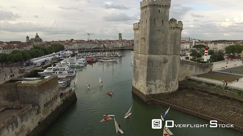 Aerial view of towers of La Rochelle leading to the Old Port. The Tower of the Chain and the Tower Saint-Nicolas, filmed by drone, La Rochelle, France
