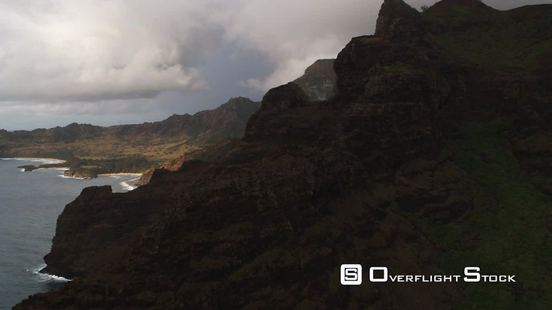 Over shadowed rock formations along cliffs of Hawaii's southwest shore to view of coastal valley