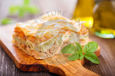 Fish and broccoli mousse lasagna on a wooden table