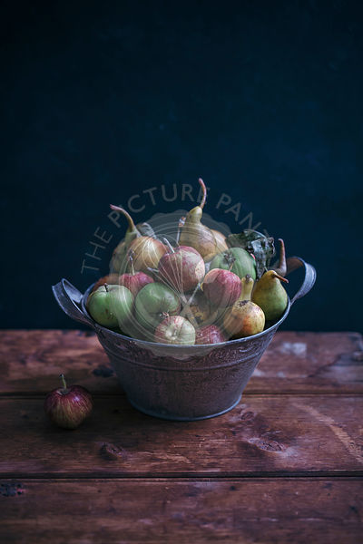 Organic apples and pears in a rustic bucket