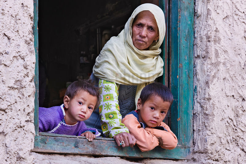 Moslem grandmother with grandchildren at window