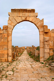 LIBYA: Leptis Magna - Arch of Tiberius, looking NE along the Cardo