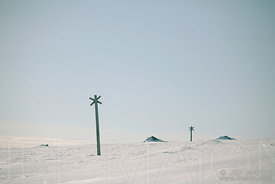 Wooden crosses marking ski trail