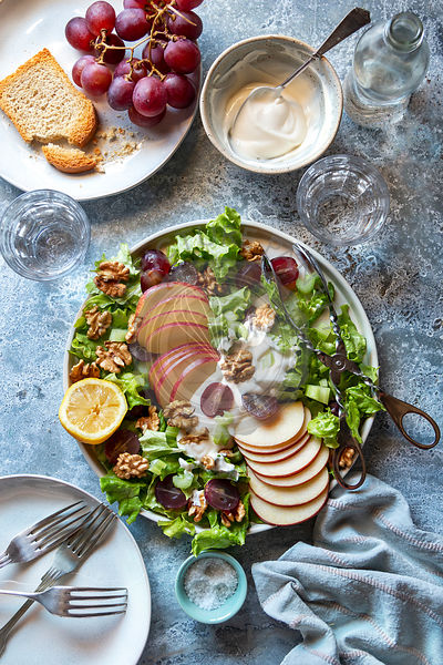 Waldorf salad with celery,apple,grapes and walnuts on a plate