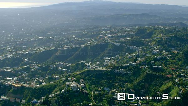 Red Epic Video looking west over the Hollywood Hills to the Santa Monica mountains and the Pacific Ocean Los Angeles California USA. Extremely rare view of the Hollywood Hills with lush green vegetation after winter rains!