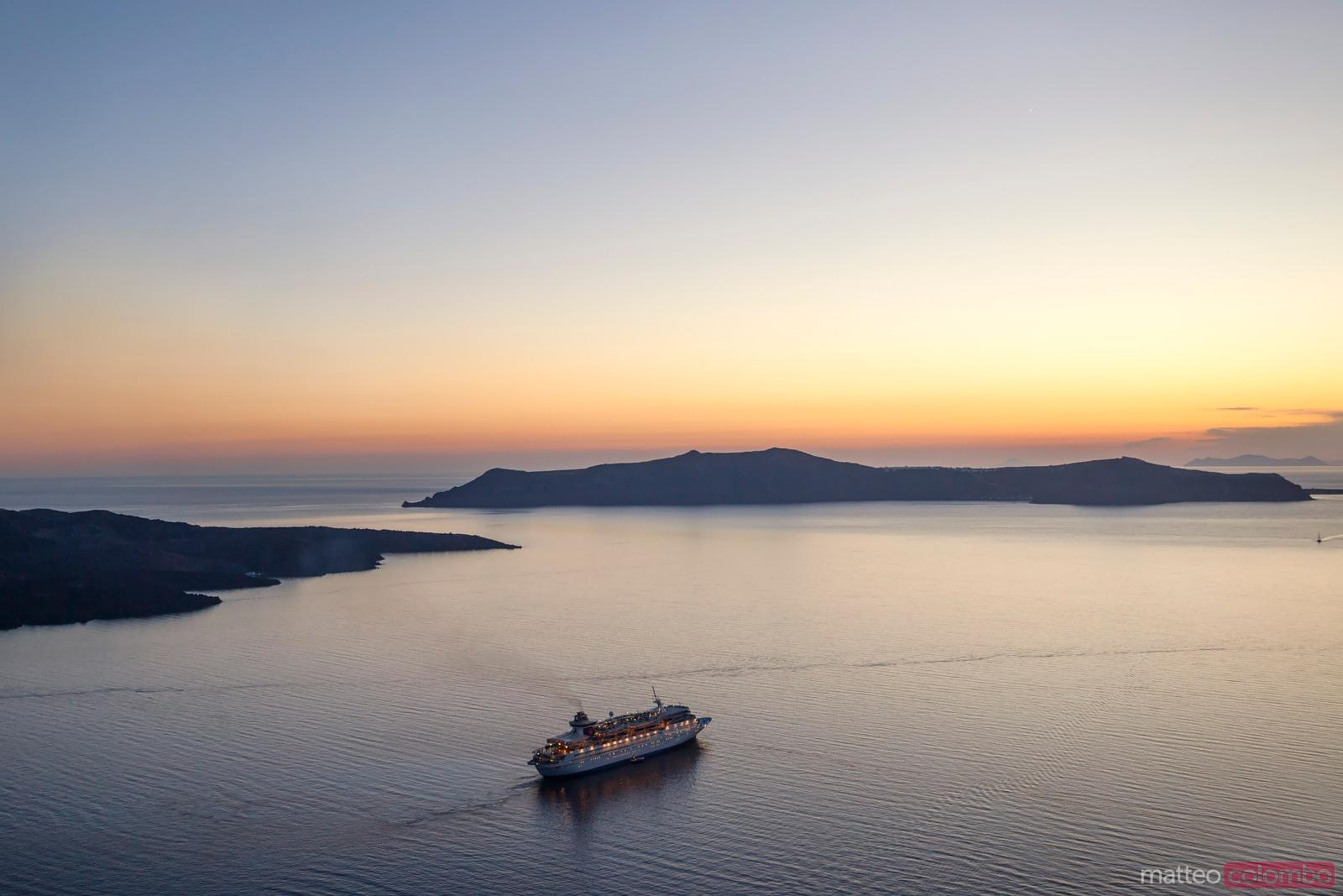 Cruise ship in the mediterranean sea at sunset