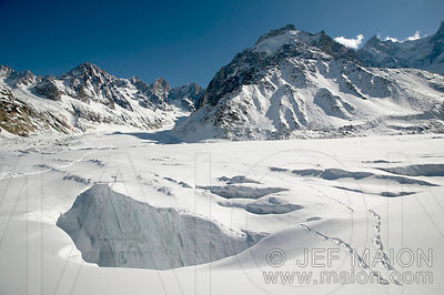 Glacier crevasse and mountain valley