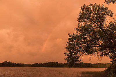 Weird orange sunrise with rainbow