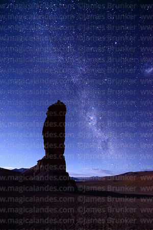 Milky Way and Large Magellanic Cloud above Moai de Tara / Monjes de la Pacana rock formation, Los Flamencos National Reserve, Chile