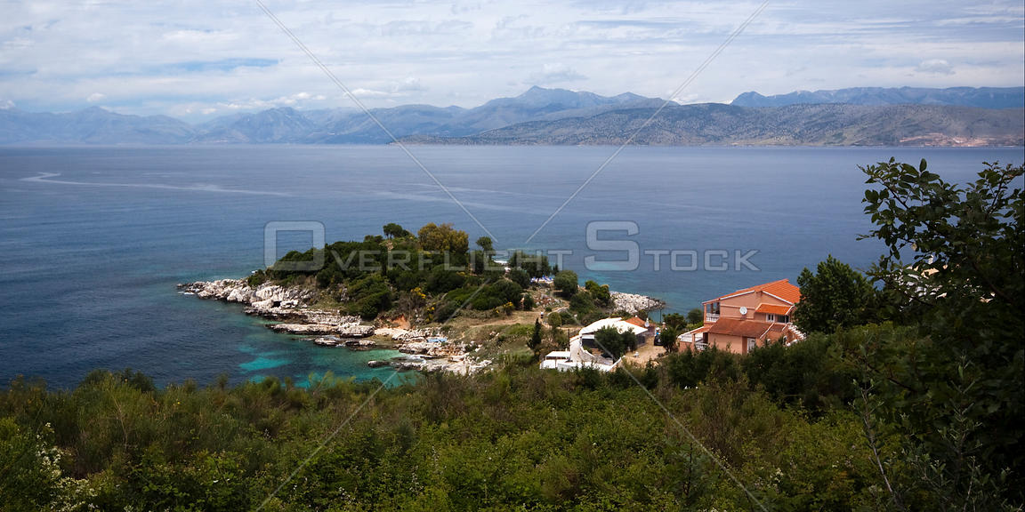 View from the top of the old castle at Kassiopi over the water to Albania, north-east Corfu, Greece, June 2010.