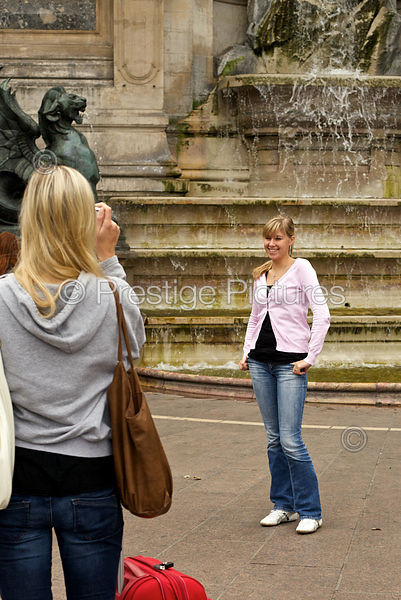 Young Woman Being Photographed by Fountain
