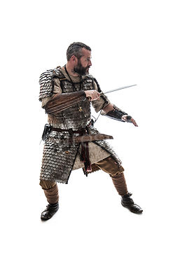 A wealthy Viking, fighting in armour – shot from eye level.