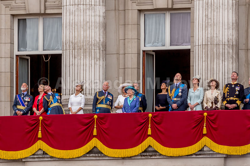 The Queen smiling broadly as she and her family watch the RAF 100 flypast