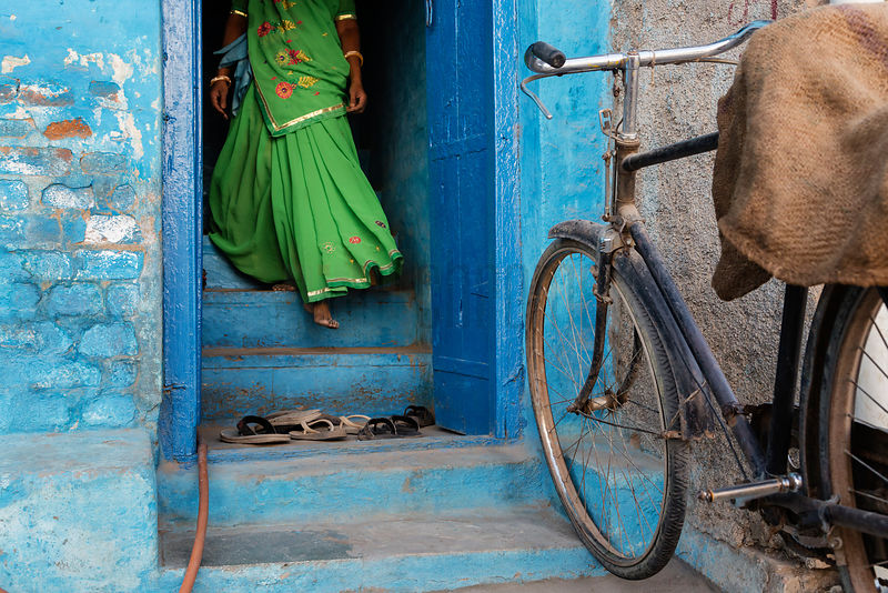 Woman in a Green Sari Walking Down Steps