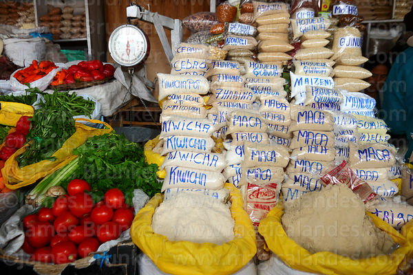 Stall selling fresh vegetables and a variety of flours in San Pedro market, Cusco, Peru