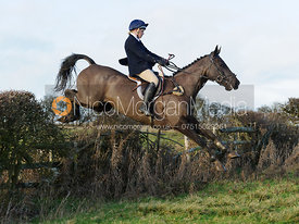 Hannah Maydwell jumping a hedge near Hill Top Farm