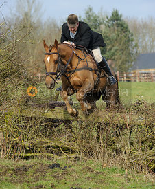 Russell Cripps jumping a fence from the meet at Lockwood