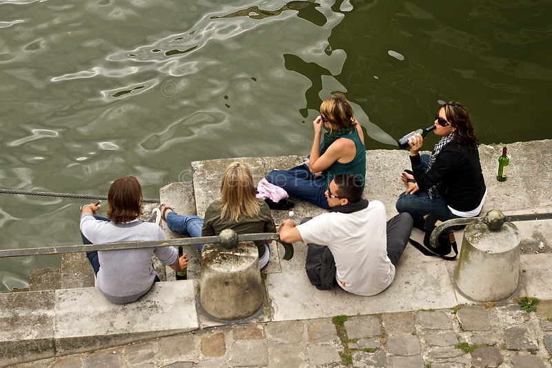 Young People Sitting by The Seine Drinking Wine