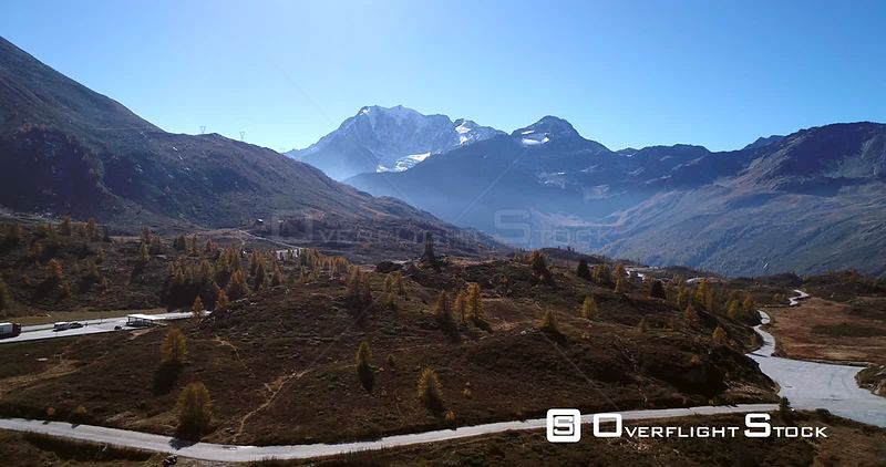 Alpine Landscape, 4k Aerial Rising View Over the Top of Simplon Pass and Away the Eagle Statue and Snowy Mountains, Sunny Autumn Day, Valais, Alps of Switzerland